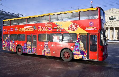Moscow, Theatral Square - Moscow sightseeing bus stays across the Big Theater.  Editorial