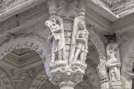 Figures of apsaras, celestial courtisans, on the wall of ancient temple  Ahmedabad, Gujarat Stock Photo
