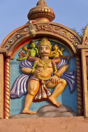 shri: Image of Shri Hanuman carring Rama and Lakshman over an ancient temple gate in  Bhubaneshvar