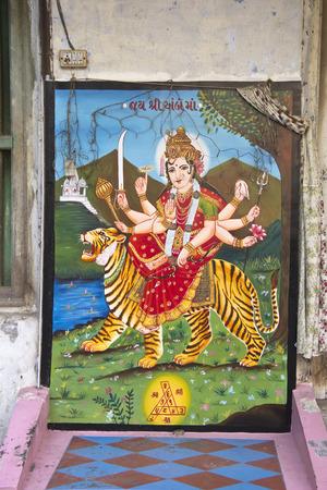 gujarat: FEBRUARY 2, 2014, AHMEDABAD, GUJARAT, INDIA - Image of Goddess Durga on a wall of little temple Editorial