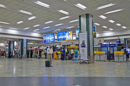 gujarat: FEBRUARY 3, 2014, AHMEDABAD, GUJARAT - Passengers waits a registration at the registration desk in Ahmedabad airport