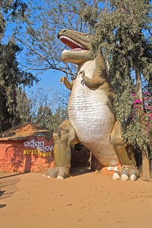 tyrannosaur: FEBRUARY 4, 2014, NANDANKANAN ZOO BETWEEN BHUBANESHWAR AND CUTTACK, ORISSA, INDIA - Entry to Reptilie Park in form of tyrannosaur