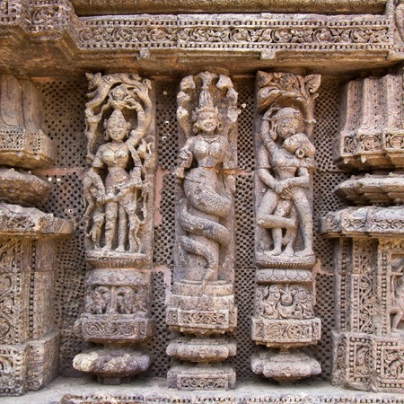 Famous erotic stone carving on the wall of ancient Sun temple in Konark Stock Photo