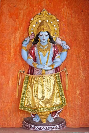 vishnu: Sculpture of Lord Vishnu on the wall of temple in Puri Stock Photo