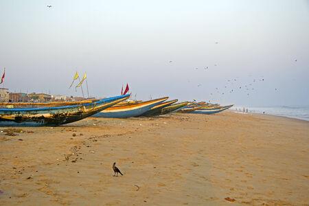 puri: Fishing boats on the beach of Bengal Bay in Puri