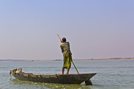 india fisherman: FEBRUARY 7, 2014, CHILIKA LAKE, ORISSA, INDIA - Unknown fisherman in the boat on Chilika lake