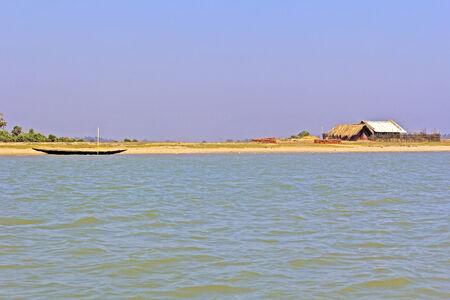 chilika: Fishing hut and boat on the bank of Chilika lake, Orissa