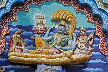 puri: Image of Vishnu Padmanabha on the snake Shesha with Lakshmi, Saraswati and Brahma on the temple wall in Puri