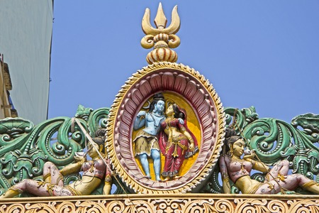 parvati: Image of Shiva and Parvati above the temple gate in Puri
