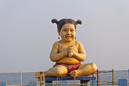 andhra: FEBRUARY 11,  2014, VISHAKHAPATNAM, ANDHRA PRADESH, INDIA - Sculpture of a little girl at Ramakrishna beach Editorial