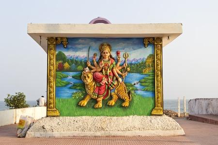 andhra: FEBRUARY 11,  2014, VISHAKHAPATNAM, ANDHRA PRADESH, INDIA - Image of the Goddess Durga on the wall of small emple at Ramakrishna beach Editorial
