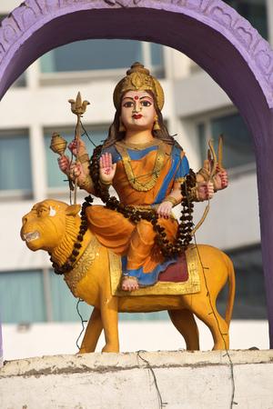 shakti: FEBRUARY 13, VISHAKHAPATNAM, ANDHRA PRADESH, INDIA - Sculpture of the Goddess Durga over the gate of little Hindu temple