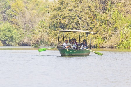 bird sanctuary: FEBRUARY 23, 2014, RANGANATHITTU, KARNATAKA, INDIA - Visitors of the Ranganathittu bird sanctuary watches the birds on the boat