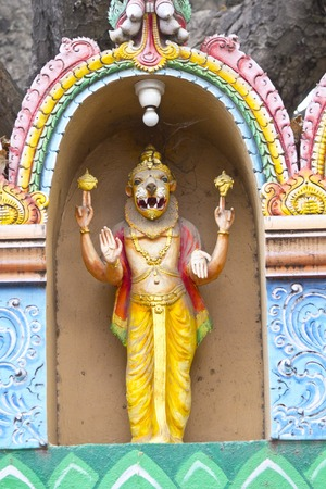 incarnation: FEBRUARY 25, 2014, BANGALORE, KARNATAKA, INDIA - Sculpture of Nrisimha or Narasimha, incarnation of Vishnu in the form of half-human, half-lion  on the wall of the Hindu temple