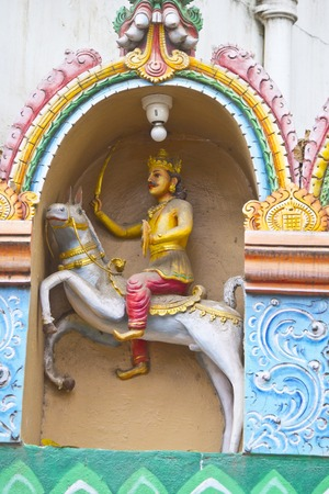 incarnation: FEBRUARY 25, 2014, BANGALORE, KARNATAKA, INDIA - Sculpture of Kalki, the future incarnation of Lord Vishnu,  on the wall of the Hindu temple Editorial