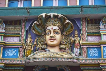 shakti: FEBRUARY 25, 2014, BANGALORE, KARNATAKA, INDIA - Face of the Goddess Durga on the wall of Hindu temple Editorial