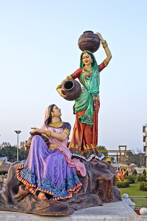 prem: FEBRUARY 27, 2014, VRINDAVAN, UTTAR-PRADESH, INDIA - Sculpture of talking gopis Lalita and Vishakha close to Prem Mandir or Temple of Love