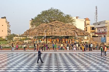 MARCH 2, 2014, VRINDAVAN, UTTAR-PRADESH, INDIA - Krishna Giridhari or Krishna lifting the hill Govardhan, sculpture composition close to Prem Mandir
