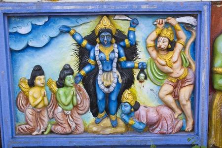 kali: JANUARY 26, 2015, INDIA, ORISSA, BHUBANESHWAR - Goddess Kali, Rama, Lakshman and Hanuman, image on the wall of the small Hindu temple