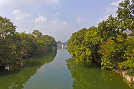 andhra: Canal, part of the River Krishna, in the central part of the town Vijayawada, Andhra Pradesh, India Stock Photo