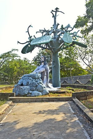 Sculpture of Jesus Christ praying under a banyan tree photo
