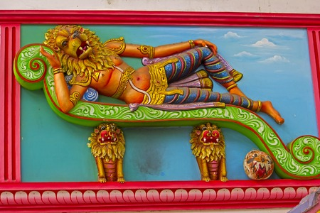 incarnation: JAN 30, 2015, CHENNAI, TAMIL NADU, INDIA - Image of relaxing Nrisimha, half-man half-lion incarnation of the Lord Vishnu, on the wall of temple Editorial