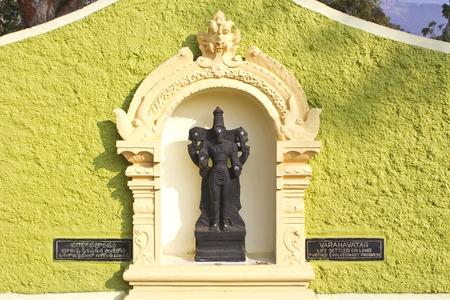 zoo as: JAN 31, 2015, TIRUPATI, ANDHRA PRADESH, INDIA - Deity of Varaha or Boar avatar at the entry of the Tirupati Venkateshwara zoo. This avatar interpretates as the third step of evolution Editorial