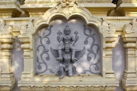 andhra: JAN 31, 2015, TIRUPATI, ANDHRA PRADESH, INDIA - Image with the mythological theme (Vishnu on Garuda) at the entry to the Tirupati Venkateshwara zoo. Editorial