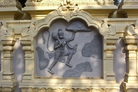 veda: JAN 31, 2015, TIRUPATI, ANDHRA PRADESH, INDIA - Image with the mythological theme (Hanuman with mountain) at the entry to the Tirupati Venkateshwara zoo.