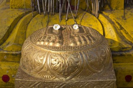 shakti: JAN 31, 2015, TIRUPATI, ANDHRA PRADESH, INDIA -  Lotus feet of the Mother Durga in the little temple Stock Photo