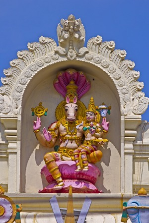 incarnation: FEBRUARY 1, 2015, TIRUMALA, ANDHRA PRADESH, INDIA - Sculpture of Hayagriva, the horse incarnation of Vishnu, with his consort Lakshmi on the wall of the temple