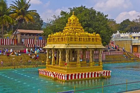 andhra: FEBRUARY 1, 2015, TIRUMALA, ANDHRA PRADESH, INDIA - Waterpond with the shrine close to Shri Balaji temple at Tirumala