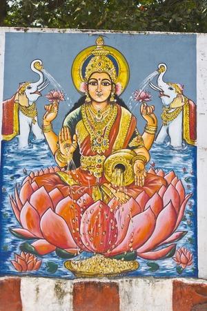 andhra: FEBRUARY 1, 2015, TIRUMALA, ANDHRA PRADESH, INDIA - Image of Gajalakshmi or Lakshmi with elephants on the wall of the Hindu temple