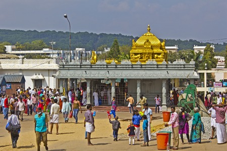 andhra: FEBRUARY 1, 2015, TIRUMALA, ANDHRA PRADESH, INDIA - People close to small Hindu temple on the sacred mountain Tirumala