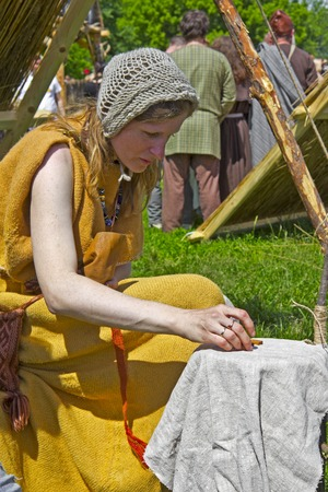 futhark: JUNE 6, 2015,  MOSCOW, RUSSIA -  Festival of the historic reconstruction Times and Ages in the park Kolomenskoye. Scandinavian fortune-teller wich uses a Runes