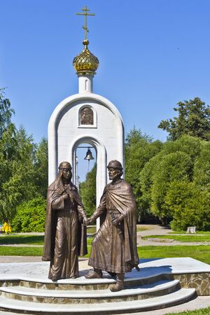 protectors: AUGUST 12, 2015, DMITROV, MOSCOW AREA, RUSSIA - Monument of saints Peter and Fevronia from Murom in Dmitrov. In russian tradition duce Peter and Fevronia are the ideal married couple, protectors of themartial fidelity Editorial