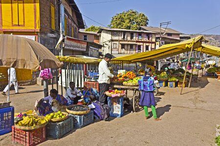 maharashtra: FEB 5, 2015, TRIMBAK, INDIA - Sales of a fruits and vegetables on a street of the village Trimbak, Maharashtra Editorial