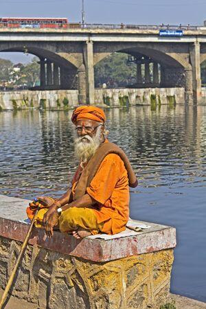 sadhu: FEB 6, 2015, NASHIK, INDIA -  Sadhu or saint on the shore of the sacred river Godavari at Panchavati area