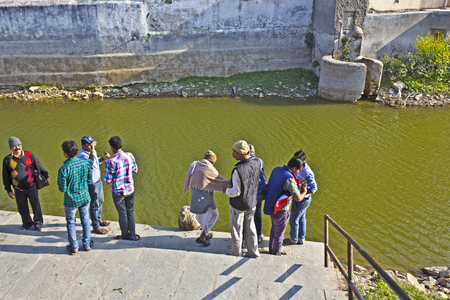 gujarat: FEB 09, 2015,  GOPI TALAV, INDIA - Hindu pilgrims on the sacred lake Gopi Talav close to Dwarka, Gujarat Editorial