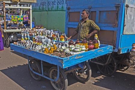 gujarat: FEB 09, 2015,  OKHA, INDIA - Trolley with souvenires in the port of Okha, Gujarat