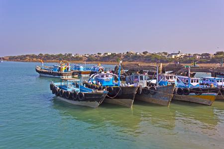 dea: FEB 09, 2015,  BET DWARKA, INDIA - Pier with boats on the island Bet Dwarka close to Okha
