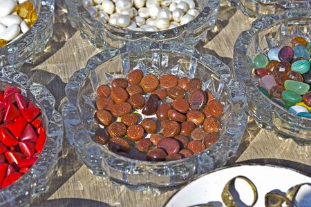 gujarat: Gems for sale on the market at the pier on Bet Dwarka island, Gujarat, India