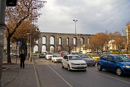 ataturk: JAN 20, 2014, ISTANBUL, TURKEY - Roman Valentine aqueduct crossing one of central street of Istanbul, Ataturk avenue