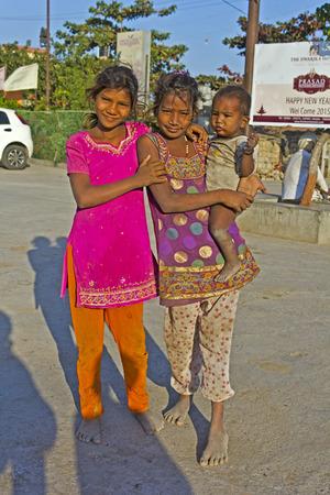 pauper: FEB 11, 2015,  DWARKA, INDIA - Little pauper indian girls