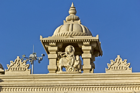 god's cow: FEB 11, 2015,  DWARKA, INDIA - Sculpture of Shri Gopal, Lord Krishna with a cow, detail of the  gate of the  Dwarka embankment