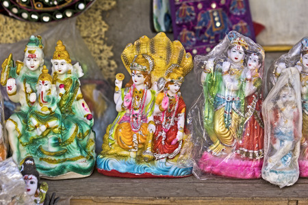 parvati: FEB 11, 2015,  DWARKA, INDIA - Souvenire sculptures of Hindu gods for sale close to Dwarkadhish temple