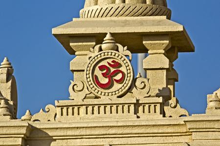 FEB 11, 2015,  DWARKA, INDIA - Sacred sign Om, detail of the gate of the  Dwarka embankment