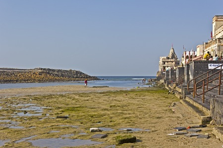 confluence: FEB 11, 2015, DWARKA, INDIA - Ghat on the confluence of the sacred river Gomati and Arabian sea on the time of low tide