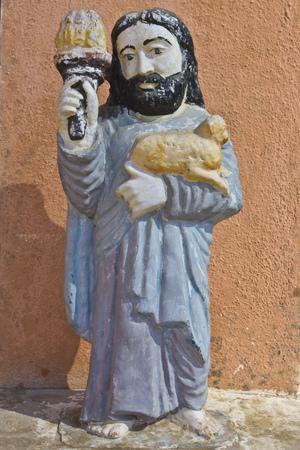 ashram: FEB 11, 2015,  DWARKA, INDIA - Sculpture of Jesus Christ on the yard of Kabir ashram Editorial