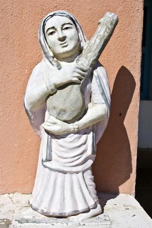 ashram: FEB 11, 2015,  DWARKA, INDIA - Sculpture of great saint poetesse Meera Bai on the yard of Kabir ashram
